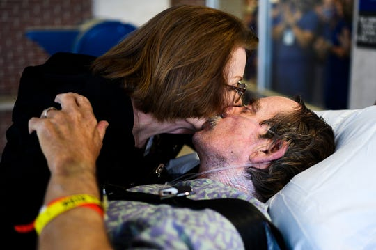 Richard Frady of Hartwell kisses his wife Sally outside of AnMed Health Medical Center before he is transferred to their rehab facility to continue his recovery from  COVID-19 Friday, May 8, 2020.