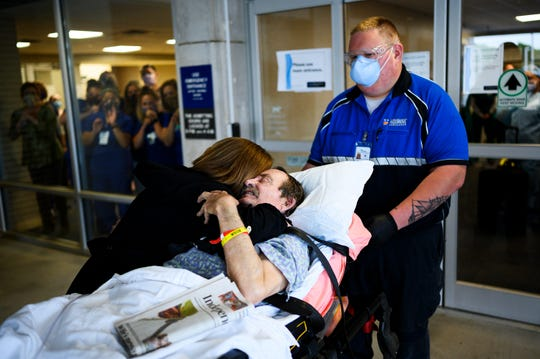 Sally Frady of Hartwell embraces her husband Richard Frady before he is transferred from AnMed Health Medical Center to their rehab facility to continue his  recovery from COVID-19 Friday, May 8, 2020.
