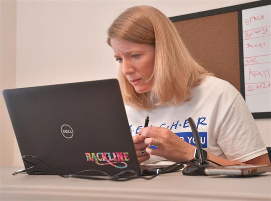 Kandice Tucker, a 12th grade AP Calculus teacher at Broome High School, uses ZOOM to work with her students remotely, from Calvary Hill Baptist Church in Pacolet, Thursday morning, May 7, 2020. Tucker drives four days a week from her home to the church, where she can use the internet connection.
