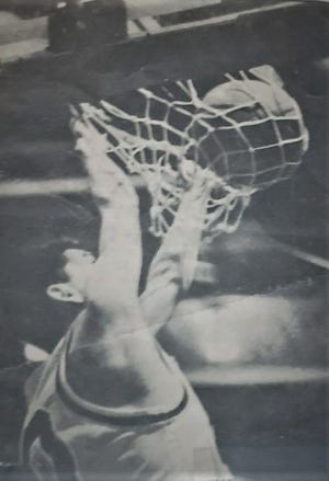 """Rocky Boy's Raymond """"Jazz"""" Parker throws one down during a District 9C game in the 1996-97 season."""