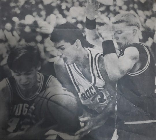 """Raymond """"Jazz"""" Parker of Rocky Boy (center) battles for possession of the ball against Matt Antonich (43, left) and Johannes Brown of Kremlin-Gildford during a District 9C game."""