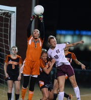 Hopkinsville goalkeeper Meredith Pace (left) deflects the corner kick as Henderson County's Carlee Crafton attempts to head the ball during the 2015 Second Region semifinal Oct. 20, 2015 in Hopkinsville.