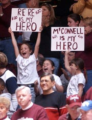 Addy Floyd, 9, left, Kendal Breedlove, 8, center, and Kailyn Lee, 8, right, cheer on the Lady Colonels and their favorite team members as Henderson County plays Marshall County in the first round of the 2006 Sweet Sixteen tournament in Bowling Green.