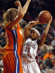 Henderson County's Sierra Gilbert (15) draws the foul from Marshall County's Jessica Holder (35) as Leah Creason (34) defends the play during the 2006 girls Sweet Sixteen in Bowling Green.