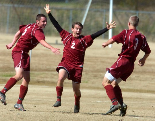 Henderson County 's Andrew Swanson, Jordan Gregory and Travis Noland, from left, celebrate after Gregory scored a goal in the first half of the 2006 Third Region soccer final against Daviess County at Deer Park Elementary School in Owensboro on Oct. 21, 2006.