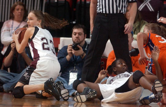 Henderson County's Sara Scales (23) looks for the opening after scrambling on the floor to recover the loose ball during the 2006 state tournament game against Marshall County in Bowling Green.