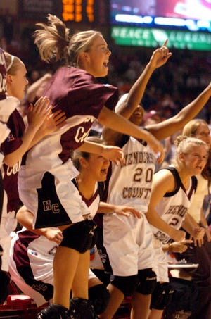 Henderson County's Allison Todd, center, and the rest of the bench jumps for joy as they near their victory over Marshall County in the 2016 state tournament game in Bowling Green on March 22, 2006.