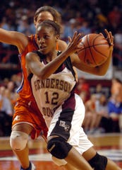 Henderson County's Rinesha Soaper (12) drives to the basket against Marshall County's Kayci Beasley (10) during the 2006 girls state tournament game in Bowling Green.