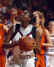 Alyse Poindexter (54) looks to the basket as Henderson County takes on Marshall County in the 2006 girls state basketball tournament in Bowling Green.=