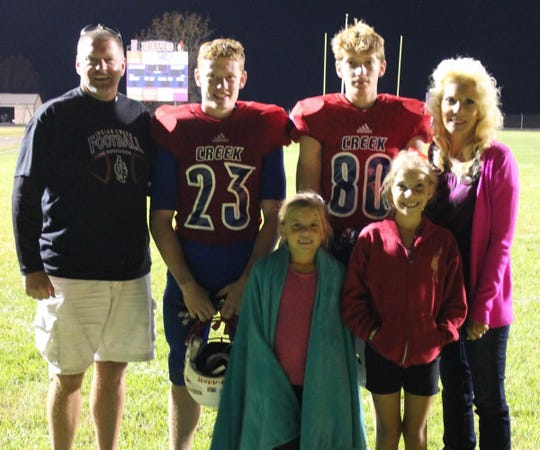 """""""The sports have changed but Lisa remains the backbone and the heart of our family,"""" said Kevin Sprong, husband to Lisa (far right)."""