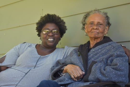 Rebecca Gibbs, left, spends time with her mother, Lettie Gibbs, right, on the porch of her home in the Washington Addition neighborhood of west Jackson, Miss. Wednesday, May 6, 2020.