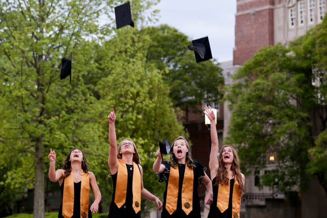Graduation photos are taken at the Gateway Arch, Thursday, May 7, 2020 at Purdue University in West Lafayette.