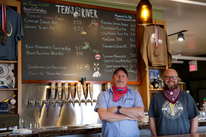 Teays River Brewing owners Jon Hodge and Jason Cook stand behind the taproom bar, Thursday, May 7, 2020 in Lafayette.
