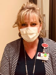 Chief Nurse Karla Zarb wears a facemask to protect patients during a shift at St. Joseph Mercy Livingston Hospital, Friday, May 8, 2020.