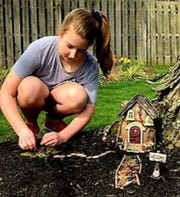 Erin Ramsey, daughter of Kris and Todd Ramsey, was inspired to make her own elf village after reading the books.