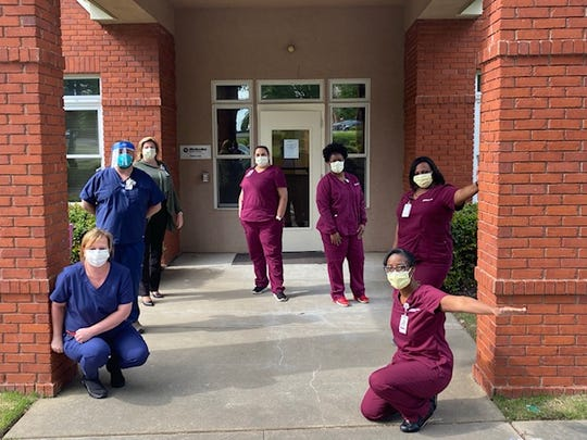 Medical workers stand outside Methodist Le Bonheur Healthcare's live COVID-19 clinic.