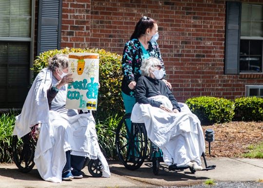 Landmark of DeSoto Nursing Home residents hold up signs  during the Mother's Day parade in Horn Lake, Miss., on Friday, May 8, 2020. Due to COVID-19 residents can't be with their families.
