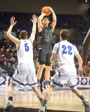Izard County's Justus Cooper shoots against Nevada in the Class 1A State championship game this past season in Hot Springs.
