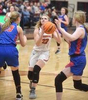 Viola's Keyaira Moore drives into the lane during state tournament action this past season at Lake Hamilton High School.