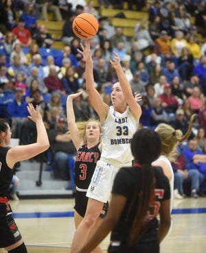 Mountain Home's Anna Grace Foreman shoots against Searcy during a home game this past season. Foreman was named to the East all-star roster Thursday for the AHSCA All-Star games.