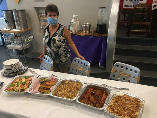 Janett Malpartida, owner of D'Road Café, 121 Montgomery St. in downtown Montgomery, with her Mother's Day special.
