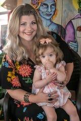 Prattville resident and mother Jonna Turberville, seated with baby Bellanova Star Turberville.