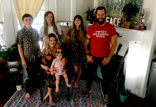 Prattville resident and mother Jonna Turberville, seated with baby Bellanova  Star Turberville, with from left, Ethan Scott, 12, Grace Scott, 18, Ariana Jayne Turberville, 17, and Jonna's husband Justin Turberville.