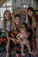 Prattville resident and mother Jonna Turberville, seated with baby Bellanova Star Turberville, with Grace Scott, 18, and Ariana Jayne Turberville, 17.