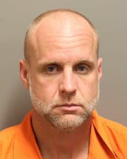 Christopher Wayne Oliver was charged with theft in connection to a storage container break-in.