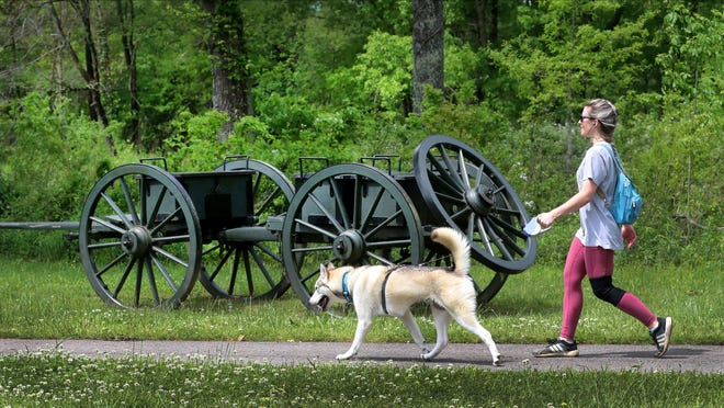 Elizabeth Hedgepath walks her dog, Beyla, at the Stones River National Battlefield on Tuesday, May 5, 2020.