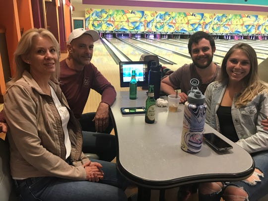 Matthew Carroll drove 12 hours from Houston, Texas to celebrate his birthday with his family at Franklin Family Entertainment Center. (Left) Peggy, Brian and Matthew Carroll his girlfriend, Kylee Harner.