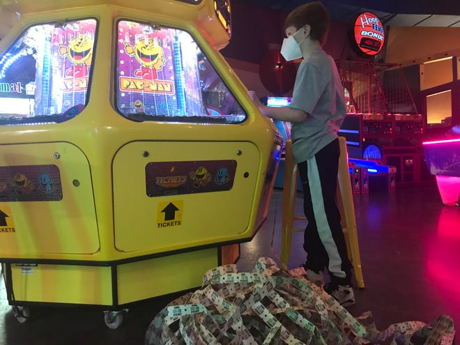Jackson Nichols, 10, couldn't wait for Franklin Family Entertainment Center to reopen so that he could play his favorite games. He was one of the first customers when the venue reopened on Friday.