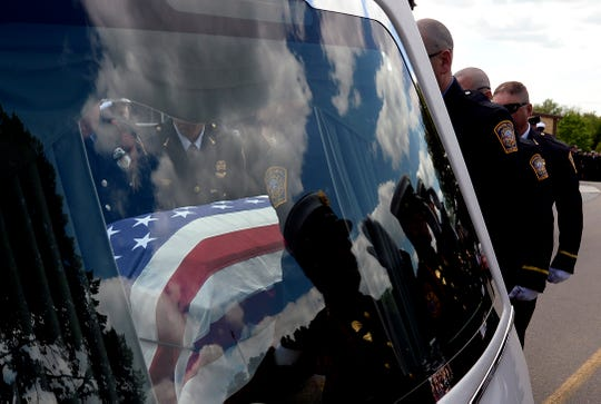 Firefighters place the casket of Spring Hill firefighter Mitchell Earwood into the hearse after the funeral service on Thursday, May 7, 2020, in Franklin, Tenn. Earwood was off-duty when he died on his family's farm during the storm that swept through Middle Tennessee Sunday night. The service was held outside the church because of social distancing guidelines during the pandemic.