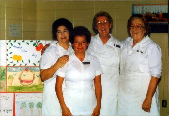 Nunzia Guardascione is pictured with her coworkers at Pelican Marsh Elementary School. Guardascione, 80 of North Naples, died because of COVID-19 on April 23, 2020.