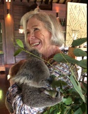 Patricia Gibbons smiles while holding a koala during a trip to Australia in Feb. 2018. Patricia Gibbons, 76, died because of COVID-19 on April 21, 2020.