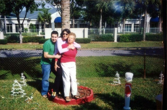 Nunzia Guardascione is pictured at her home with her children Luciana Guardascione and Carlo Guardascione.  Nunzia Guardascione, 80 of North Naples, died because of COVID-19 on April 23, 2020.