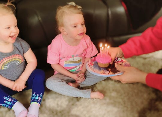 Maci Whisner playing with her sister Everly.