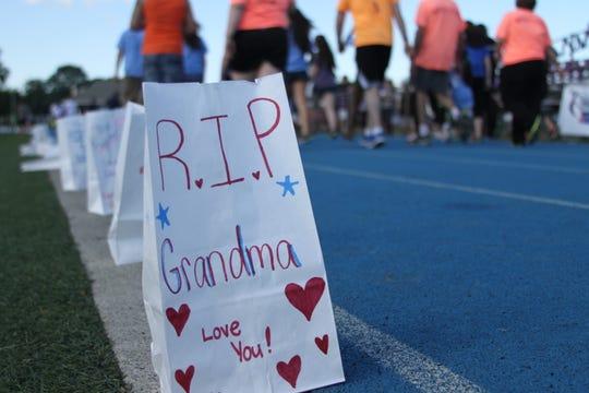 Luminarias lined along the running track at Wayne Valley High School at a past relay.