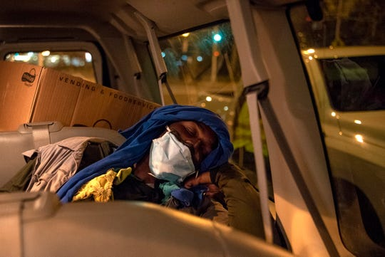 During the coronavirus pandemic the Bridges outreach team is working overtime to place the homeless population in Newark in housing. Ahmid Hatcher, homeless for three years, rests in the Bridges Outreach van while he waits for transport to the H.E.L.P Center on May 7, 2020 where he will stay off of the streets.
