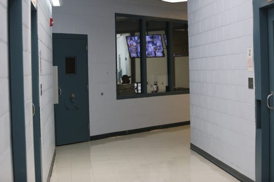 An official mans the control room in the Doña Ana County Juvenile Detention Facility in Las Cruces on Friday May 8, 2020.