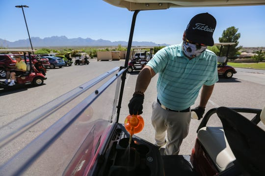 Vernon Bane cleans a golf cart at the Sonoma Ranch Golf Course in Las Cruces on Thursday, May 7, 2020.
