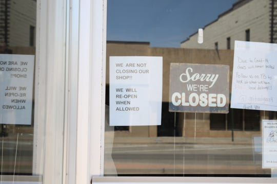 A sign on the door of the K and K Boutique in downtown Artesia shows the business has been closed due to government public health orders on COVID-19.