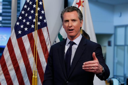 FILE - In this April 14, 2020, file photo, California Gov. Gavin Newsom gestures during a news conference at the Governor's Office of Emergency Services in Rancho Cordova, Calif. Facing an array of unknowns from the coronavirus crisis, California will send every voter a mail-in ballot for the November presidential election, Newsom announced Friday, May 8. (AP Photo/Rich Pedroncelli, Pool, File)