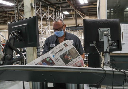 Desert Sun press operator Wendell Saxton works on publishing the most recent issue of USA Today at the newspaper's printing press in Palm Springs, May 7, 2020