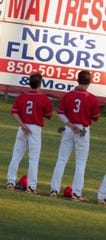 Pace seniors JC Peacher (3) and Parker Tubb await the start of a game at Pace High.