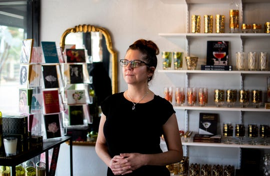 Kim Wessinger, owner of RegencyMod in Old Town Scottsdale, stands for a portrait in her store on its first ever day open, May 8, 2020. It was the first day of reopening for barbershops, salons and some retailers.