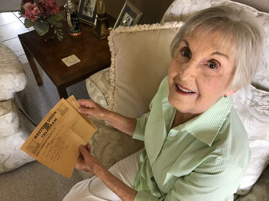Sonia Burns with a copy of the telegram she found bearing the name of one of Sen. John McCain's ancestors.