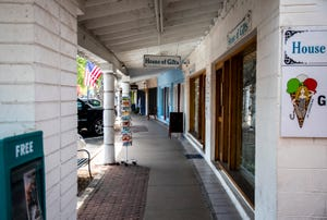 A walkway in Old Town Scottsdale sits empty on May 8, 2020, the first day of reopening for barbershops, salons and some retailers.