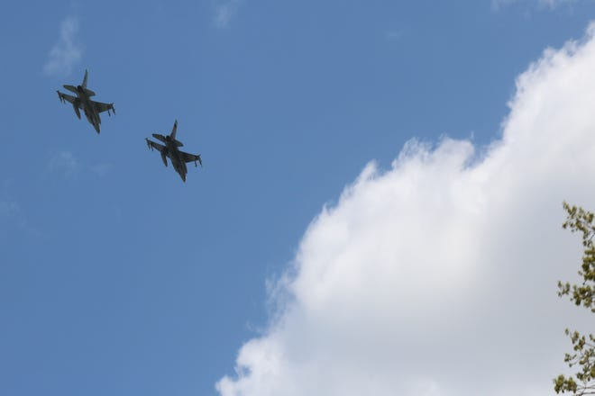 Two F-16 fighter jets from the Ohio Air National Guard's 180th Fighter Wing flew over Magruder Hospital Thursday to salute the heroes working at the forefront in the battle against COVID-19.