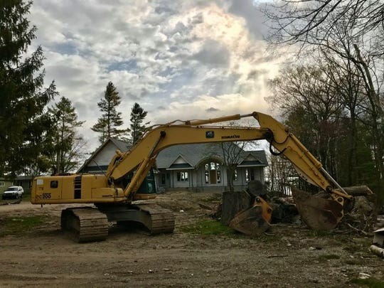 LaDuke Construction works on a Lexington Township home after Gov. Gretchen Whitmer signed an executive order allowing construction companies to reopen operations in the state.